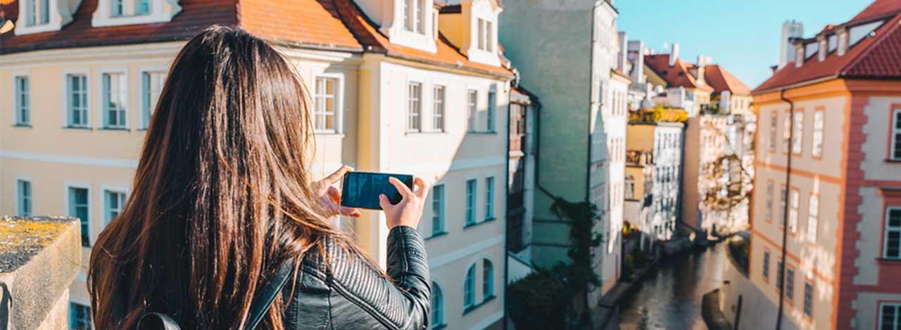 Exclusive Cruise Savings - Woman taking a photo